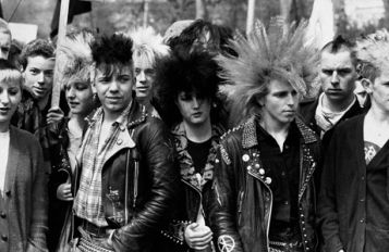 Colorful punk style is on display in this group of marchers at the Youth Campaign for Nuclear Disarmament's Rock the Bomb Festival of Peace in Brixton, London, May 7, 1983. (AP Photo/Press Association)
